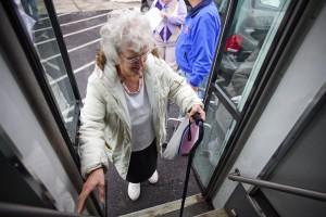 elderly-lady-boarding-bus